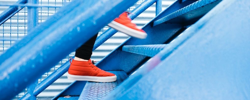 view of someone's shoes running up stairs