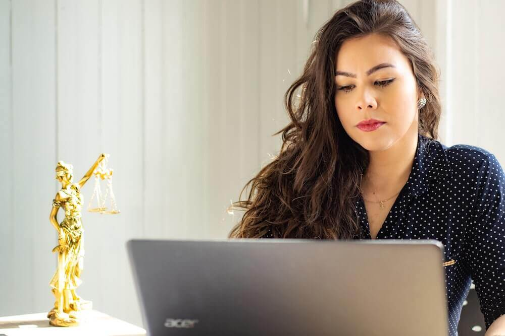 law student studying on laptop