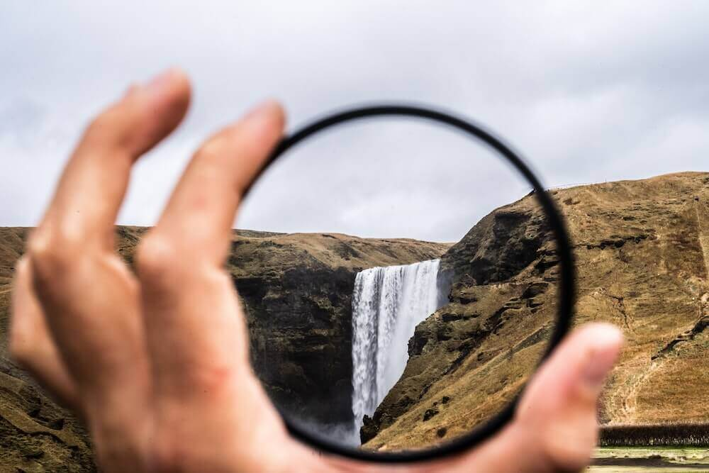 viewing waterfall clearly through a lens